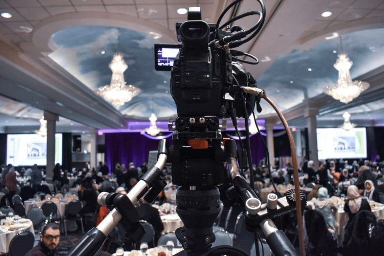 Canva – Professional video camera recording event in ballroom (1)